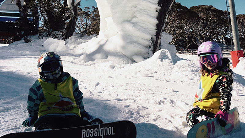 Kids snowboarding in Thredbo