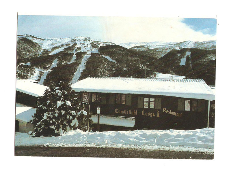Old photo of Candlelight Lodge covered in snow